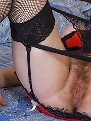 Red Bunny wears sexy lingerie and stockings to bed